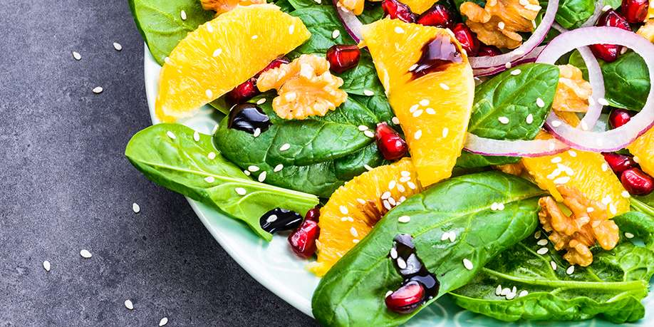 Spinach Salad with Walnuts, Oranges, Pomegranate, and Sesame Seeds