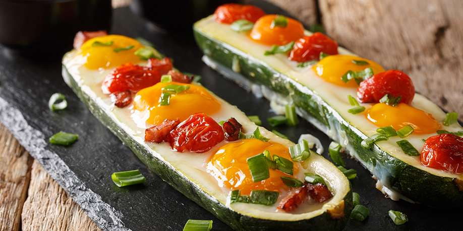 Zucchini Stuffed with Fried Eggs, Chicken and Tomato